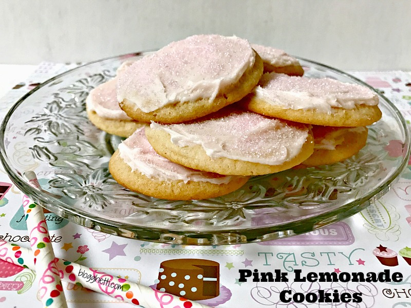 Pink lemonade concentrate gives these Pink Lemonade Cookies a tart treat inside and out. Frosted with a quick homemade icing and sprinkled with pink sugar crystals, the cookies will be a hit for a refreshing sweet summertime treat.