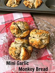 Mini versions of Garlic Monkey Bread are the perfect accompaniment to any pasta dish.  Kids of all ages love them and they're great to pull apart and dip into marinara sauce, too.