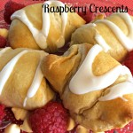 These White Chocolate and Raspberry Crescents are a sweet way bring a smile a special someone's face. Flaky crescent rolls are filled with white chocolate and fresh raspberries, and baked till golden brown.