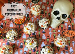 These Halloween Popcorn Balls are a great Halloween treat. It's a simple marshmallow popcorn recipe filled with candy corn and Reese's Pieces with the perfect amount of gooeyness and sweetness. The candy corn and Reese's Pieces add the perfect Halloween colors, too.