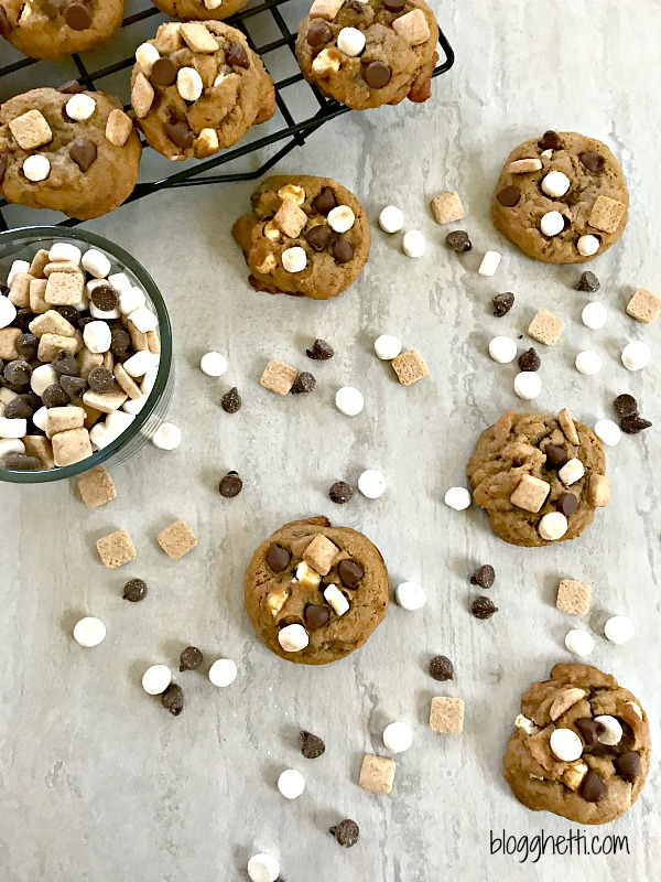 All of the delicious flavors of s'mores packed into these soft and chewy cookies.  Tiny marshmallows, graham crackers, and chocolate chips fill these S'mores Cookies and no campfire needed!