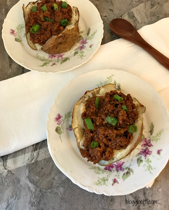 Sloppy Joe Stuffed Baked Potatoes - a new twist on a classic. Baked potatoes stuffed with an easy stove-top sloppy joe mixture makes for a healthy and easy weeknight dinner.