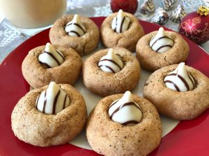 These Eggnog Blossoms are a festive addition to your holiday cookie trays. The cookies are soft, chewy, and full of traditional eggnog flavors with a white chocolate kiss in the center. #ChristmasSweetsWeek #sponsored #eggnog #cookies