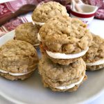 Oatmeal Maple Cream Pies are made with a maple cream filling sandwiched between two soft and chewy oatmeal cookies. #ChristmasSweetsWeek #cookies #oatmeal #maple #sponsored #baking