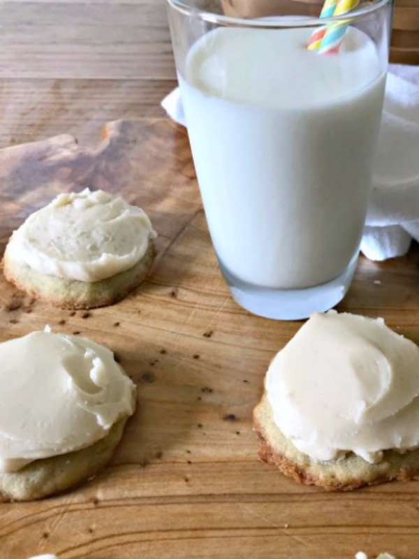 Frosted banana nut bread cookies and a glass of milk