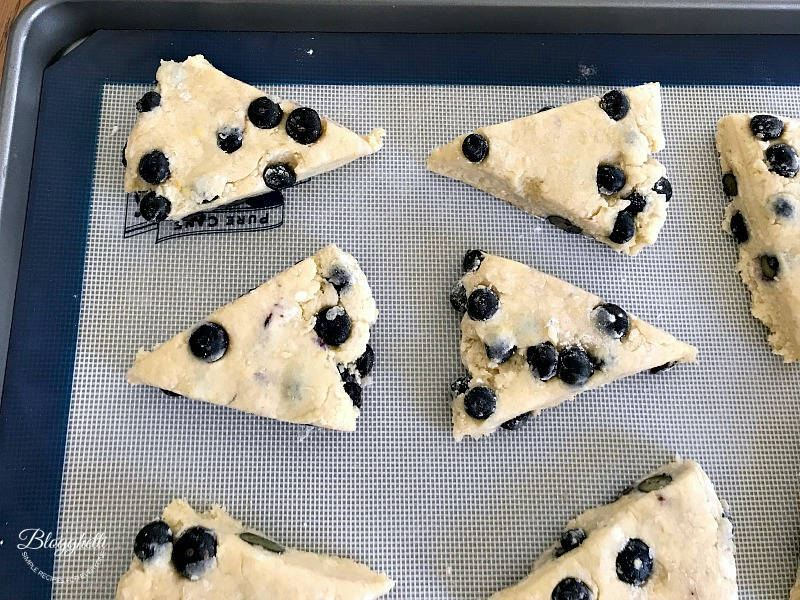 Cut lemon blueberry scones ready to bake