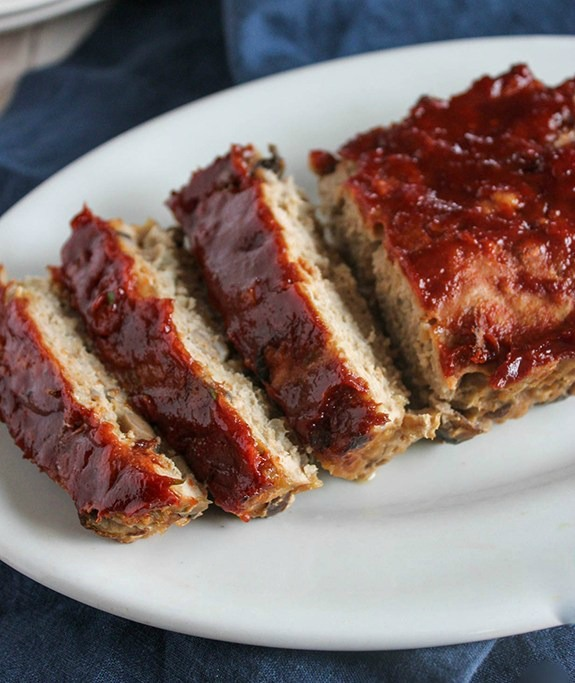 turkey meatloaf sliced and on a white platter