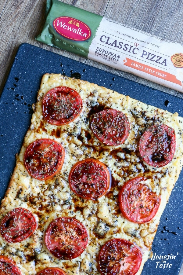 Cheddar-and-Fresh-Tomato-Pizza- on blue platter