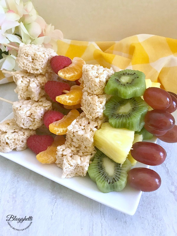 Fruit and Rice Krispies Treats Kabobs on white plate