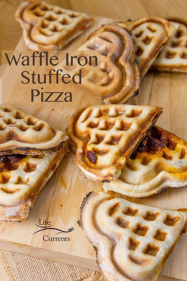 heart shaped waffles iron stuffed pizza on wooden board
