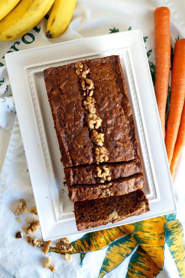 sliced loaf of Vegan Carrot Cake Banana Bread on a white plate