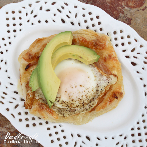 puff pastry croque madame on white plate