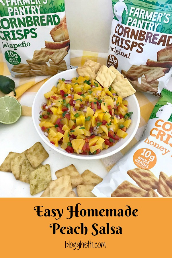 homemade peach salsa in whilte bowl with Farmer's Pantry connbred crisps