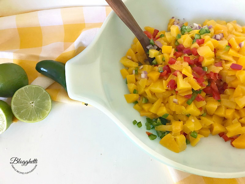 peach salsa ingredients in a Mixing bowl